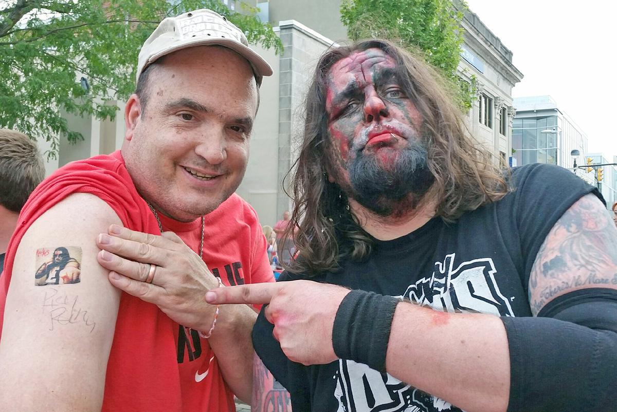 Alan Majors has his picture made with one of his favorite pro wrestlers, Ricky Ruckus, when he appeared in a match in Columbus, Indiana. Because the staff knows and honors Alan's interests and choices, attending this event was a priority.